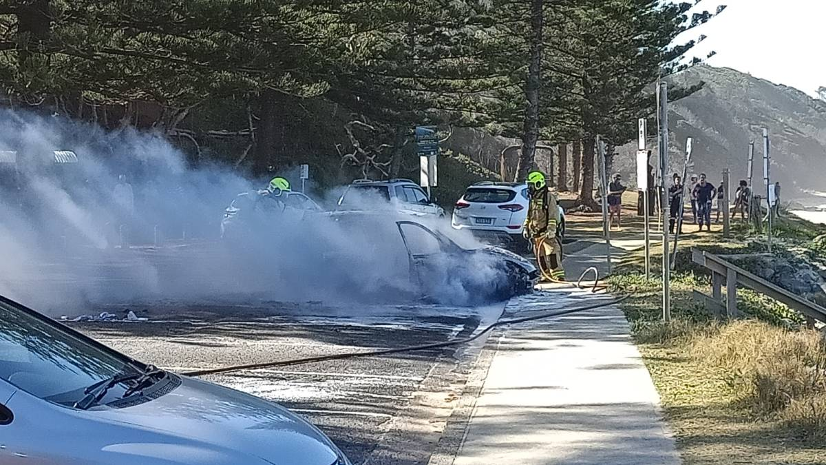 The car was destroyed by fire while in the carpark at Shelly Beach, Port Macquarie. Photo and video courtesy: Steve Drew.
