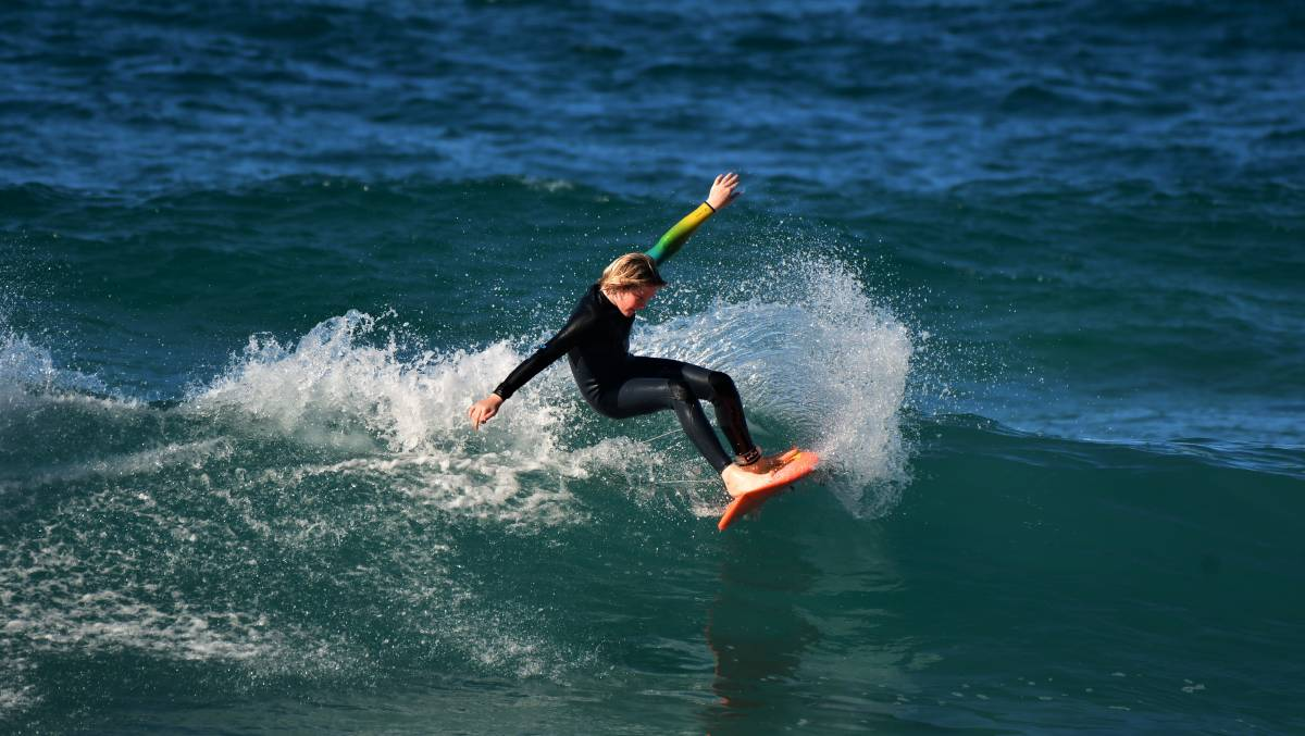 Looking good: Oli Hudson catches a wave at Flynns Beach ahead of the weekend's surf training camp. Photo: Paul Jobber