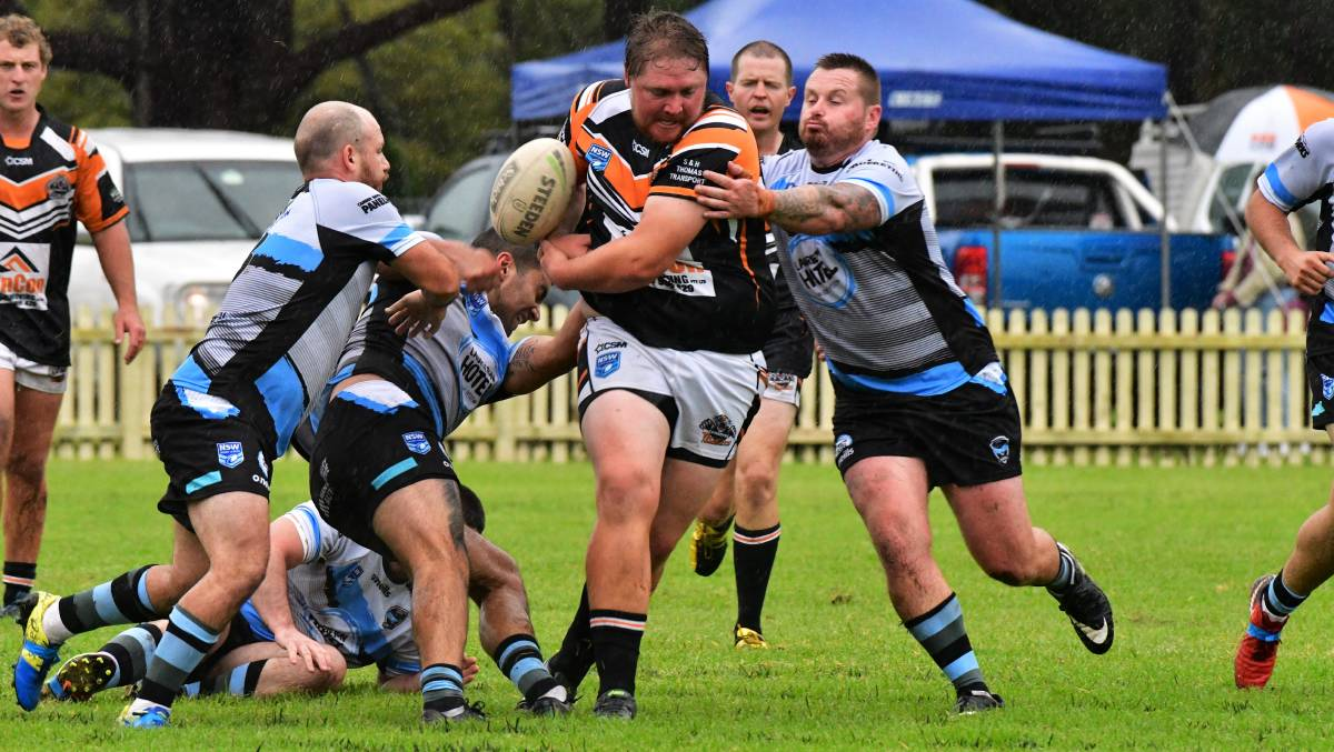 Oops: A Comboyne front-rower makes an error at Laurieton on Saturday.