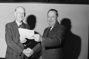 Honour: Mervyn Wheeldon receives a telegram sent by the Prime Minister, J.G. Gordon and presented by Harold Green, 1970. Photos: Supplied by Port Macquarie Museum.