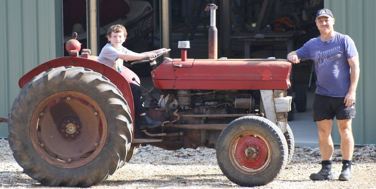 BETSY: Jack and Brett Williams polishing up the old farm machinery.