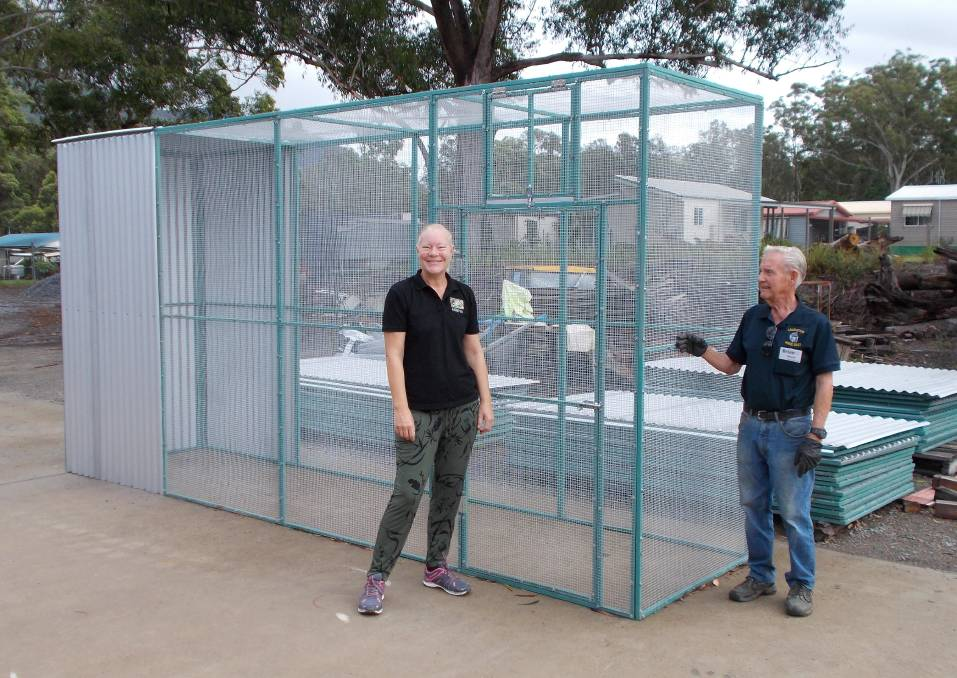 Vital infrastructure: FAWNA committee member Yvette Attleir and Men's Shed Laurieton project team manager Brian Woods with one of the large enclosures.