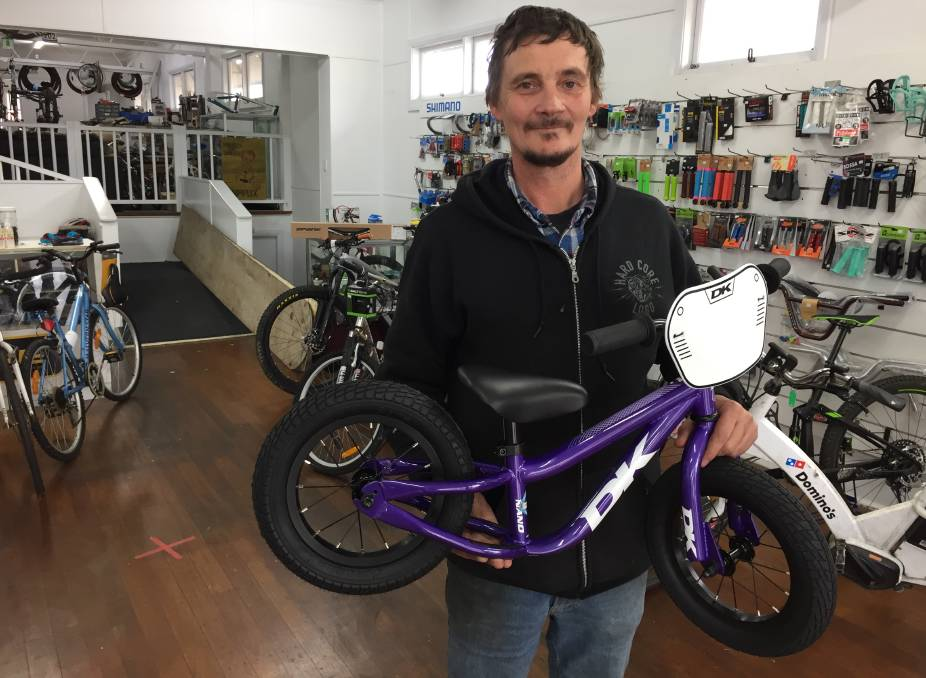 Dean Grace of Deano's Bicycle Repairs with the only new bike he has left in his store.