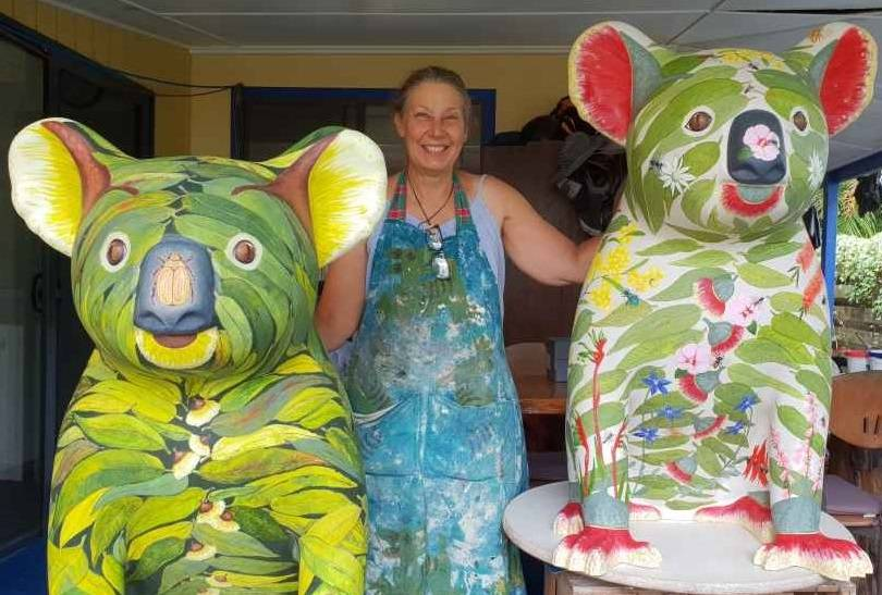 Artist Lisa Burrell with two of her Hello Koalas, the original much-loved Bushby which is joining the Hello Koalas touring exhibit and Buzzy Bee, which made a hit in Canberra but has not been seen yet in Port Macquarie.