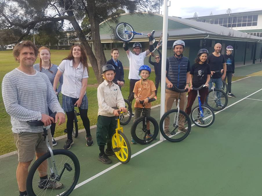 ON A ROLL: Unicyclists gather at netball courts in Port Macquarie.