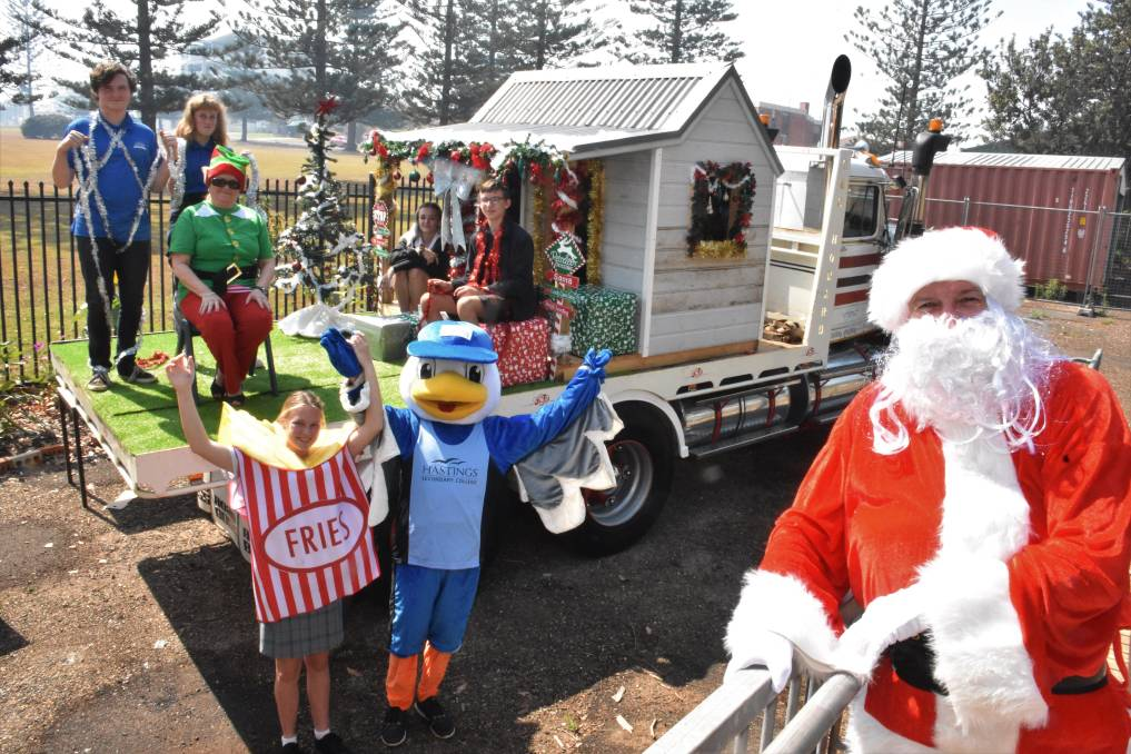 FLOAT BUILDERS: Hastings Secondary College students working on the Santa House parade float in Port Macquarie with mascots Chips, Steven Seagull and Santa (Ian Ross).