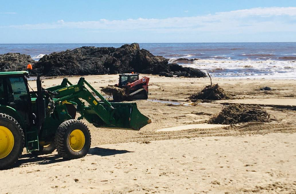 Beach focus: Heavy machinery at work earlier in the week to clean-up flood debris on Town Beach. Photo: Tracey Fairhurst
