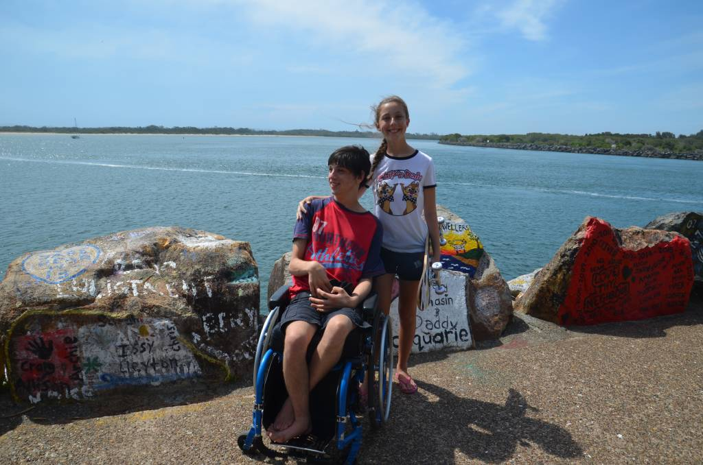 Accessible path: Braeden and Amelia Jones take in the view from the Port Macquarie breakwall.