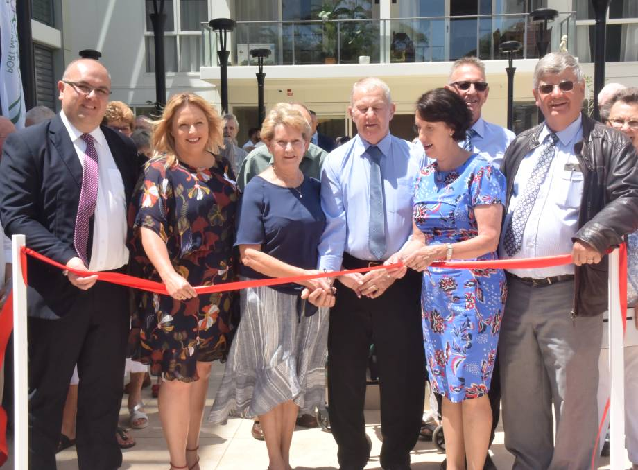 Celebration: Garden Village chief executive officer Craig Wearne, mayor Peta Pinson, resident representatives Val and Barry Monkton, Port Macquarie MP Leslie Williams, Garden Village projects manager Tim Everson and Garden Village Board chairman Noel Atkins at the ribbon cutting.