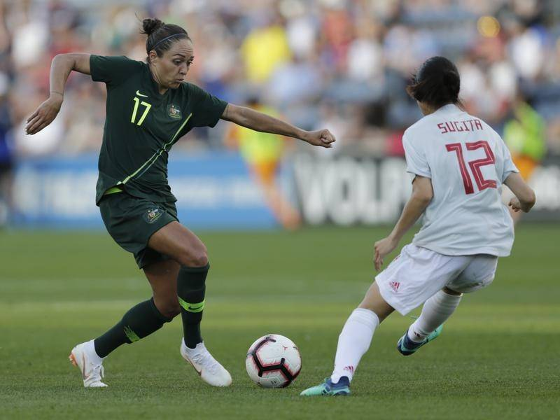 Matildas forward Kyah Simon (L) is hoping to add to her 87 caps in November against Chile.