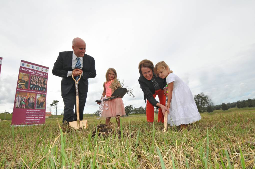 Turning the earth: Minister for Education Adrian Piccoli, 5-year-old Charli Collins, Port Macquarie MP Leslie Williams and Lelani Dietrich help turn the first sod at the new Lake Cathie School site.