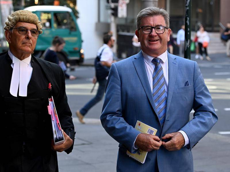 Veteran journalist Stephen Barrett (right) is on trial accused of blackmail.