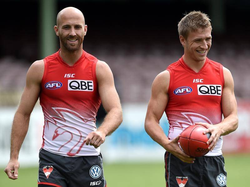 Jarrad McVeigh (left) and Kieren Jack play their last AFL games for the Swans against St Kilda.