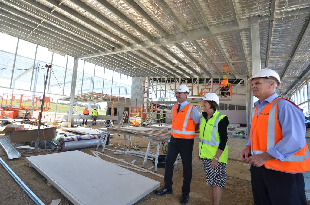 On schedule: Lake Cathie Public School principal Jock Garven, Port Macquarie MP Leslie Williams and project manager Garry Fricke at the entrance to the auditorium.